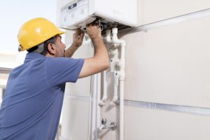 technician-working-on-gas-powered-boiler